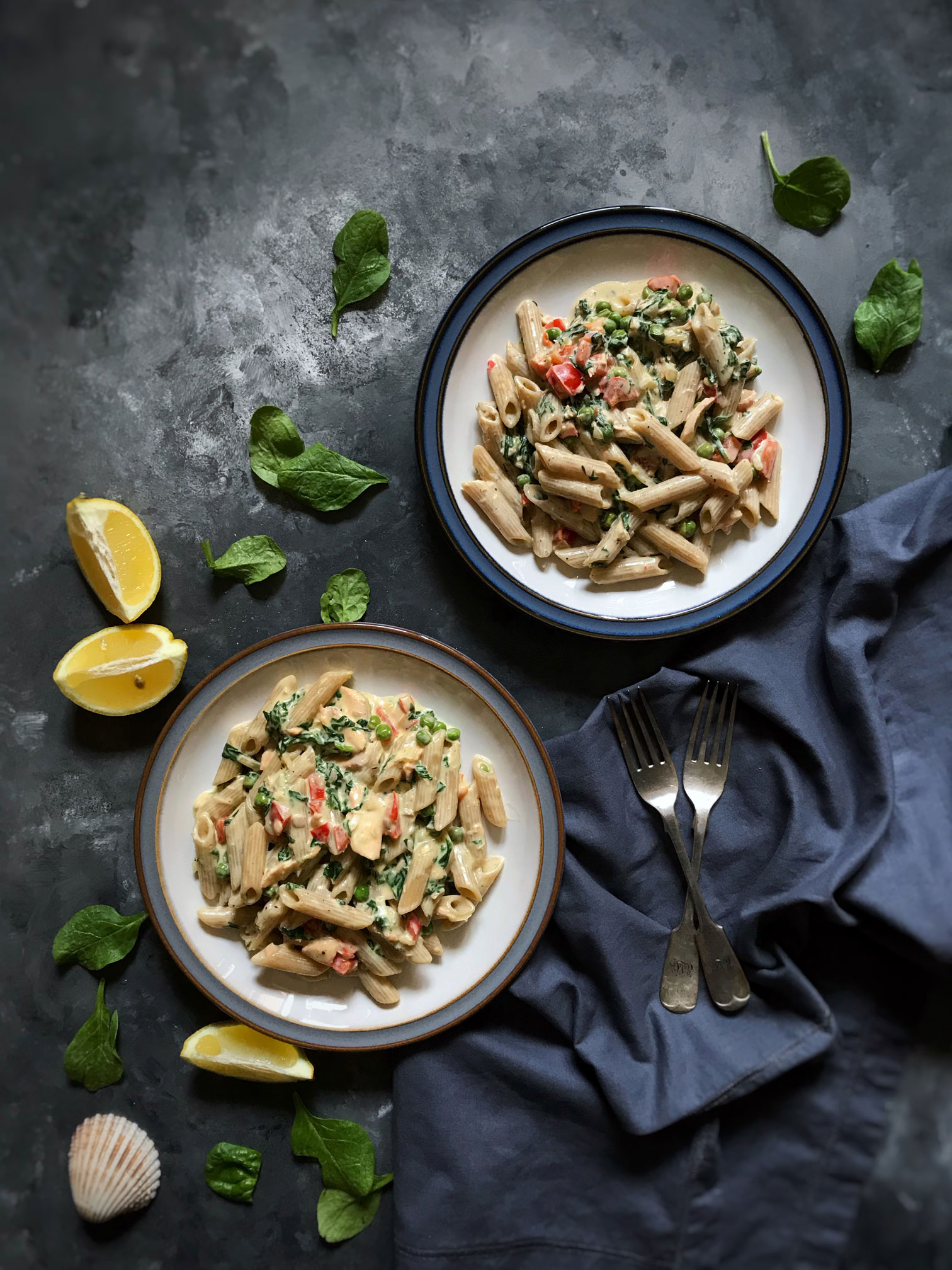 Salmon and veggies whole-wheat pasta in a dairy free cream sauce