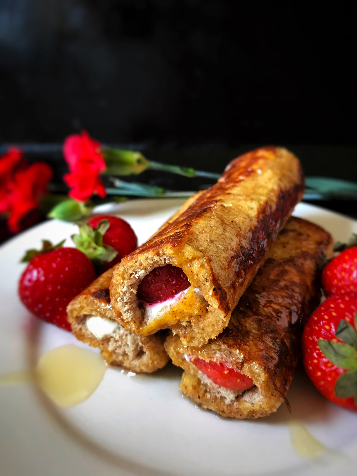 French toast rolls filled with cream cheese and strawberries